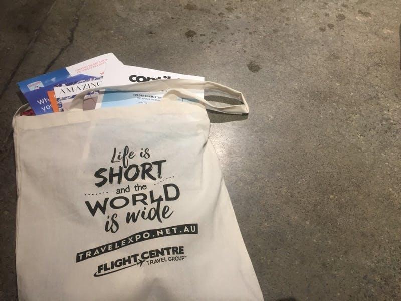 ▲World Travel Expo 2019の様子:バックに配布物